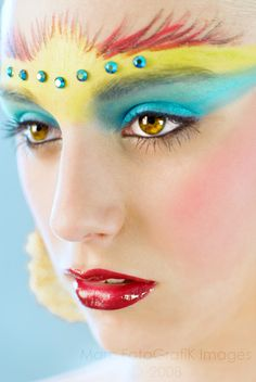 Colorful make-up mask with blue crystal accents.