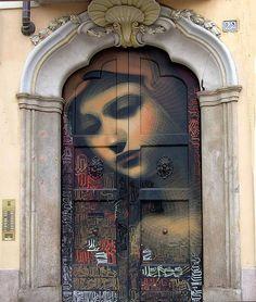Stunning street art on an Milan, Italy entryway.  travel. doors of the world. Europe. door art.