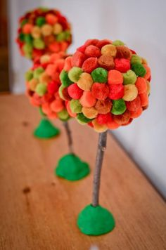 """10 AWESOME AUTUMN TREE CRAFTS - Fall Topiaries - This page says """"These topiaries, made of pom-poms covering styrofoam balls, would make delightful centerpieces for your fall dinners."""" I love the fantasy look of them and think they would make ADORABLE little trees for child play!"""