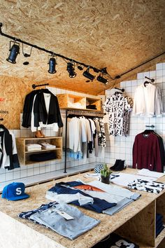 Creative Retail Store Design Using OSB and Tile - Design Milk Retail Store Design, Retail Shop, Chipboard Interior, Visual Merchandising Displays, Retail Displays, Shop Displays, Window Displays, Suit Stores, Retail Interior