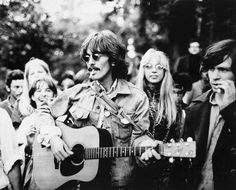 George Harrison and Patti in San Francisco 1967….He was tripping and was mobbed and given a guitar to play when all he wanted to do was observe the flower power city…well it was already going darker by this time and after this experience he knew that he needed something with more, shall we say deeper substance.