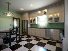 The great double doors, the dramatic B/W floor tiles, the built in corner dining booth & the light fitting are what gives the room the Deco Look. The kitchen units are quite plain & not really noticed because your eye is drawn to the bolder elements of the interior.