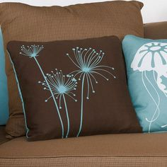 The decorative Papyrus throw pillow in lovely chocolate and aqua is hand printed on soft organic cotton twill.