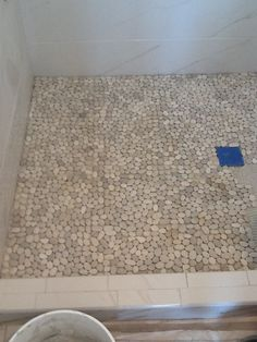 pebble tile shower floor I'm sorry.how does this get cleaned? Can you even imagine the soap scum? It's a death trap. Shower Tile, House Bathroom, Home, Pebble Tile, Remodel, Home Remodeling, Bath Remodel, Flooring, Shower Floor