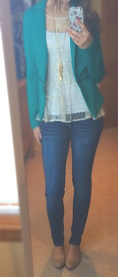 Lace top, teal ponte blazer with zipper detail, gold feather necklace, skinny jeans and flats.