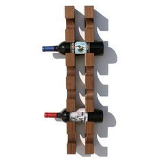 wall mountable wine rack easy to hang, attractively displays up to six bottles of wine. Designed by Matt Eastvold, Manufactured by Eastvold.