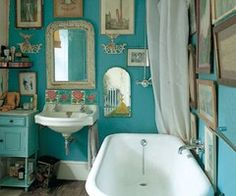 this color is very 'bohemian'.... plus, i like the idea of painting a vanity for erin's bathroom... see far left.  not hand painting- professionally having it done.  and adding super cool, almost door knocker type of handles.  i would usu opt for a pedestal sink or wall mount sink in that area, but if you want extra storage- i'd go with this option, plus a vessel sink/bowl if you're down?