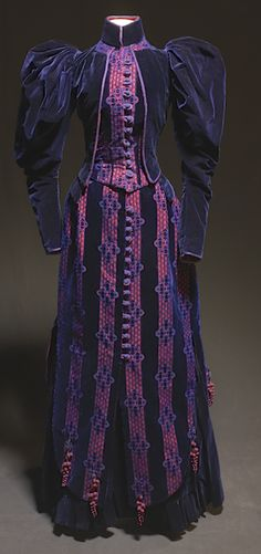 Full view of SilkDamask: L'Heure Bleu….A Gown of Midnight Blue Velvet. Designed to impress by deception, the 1890s walking gown reveals as much about society as it does about fashion. (Irma Bowen Textile Collection at the University of New Hampshire.)