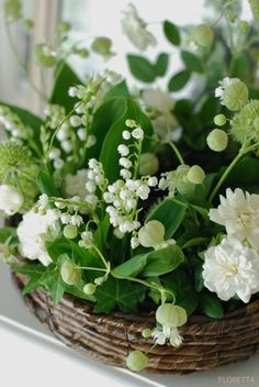"""Baskets of """"spring white"""" flowers."""