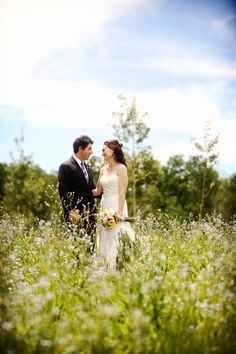 bride and groom portraits in a wildflower field from a Utah wedding| photo byPepper Nix Photography