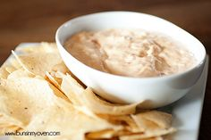 CREAMY WHITE QUESO DIP  2 8-ounce packages cream cheese, softened 1/2 cup mayonnaise 2 cups grated Monterey Jack cheese 2 cups grated Parmesan 1 can Rotel Diced Tomatoes with Green Chiles, drained 1/2 teaspoon salt