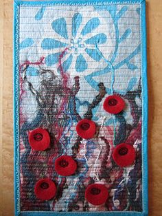 Nina was inspired to make this mini quilt by a song about grasshopper father and son. Sweet. Plus she's giving it away to a reader.