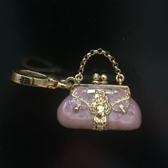 Juicy couture handbag charm Pink enamel juicy couture charm. Great for charm bracelets or wearing on a long chain Juicy Couture Jewelry