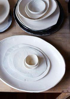 Handmade white ceramic plate. Love the various organic oval shapes.