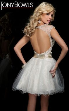 Illusion short prom dress with curved neckline and sheer cap sleeves from Tony Bowls Evenings.