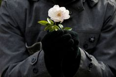 A protester holds a flower during a demonstration to show solidarity with the citizens of Aleppo, Syria, outside the Israeli prime minister's residence in Jerusalem; a portrait of Steve Jobs made of computer keyboards by students of the Ukrainian Computer Academy SHAG in Mariupol city in Ukraine; and former astronaut and U.S. Sen. John Glenn lies in state under a Marine honor guard in the rotunda of the Ohio statehouse in Columbus. These are some of the photos of the day… Ukraine Cities, Aleppo, Photos Tumblr, Syria, John Glenn, Prime Minister, Honor Guard, Jerusalem, Steve Jobs