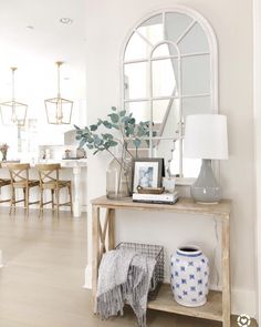 Entry way styling Benjamin Moore classic gray wood console table arched mirror neutral decor wood stools brass kitchen lanterns Interior Design Living Room, Living Room Decor, Flur Design, Decoration Design, Home And Deco, My New Room, Entryway Decor, Foyer Table Decor, Front Entry Decor