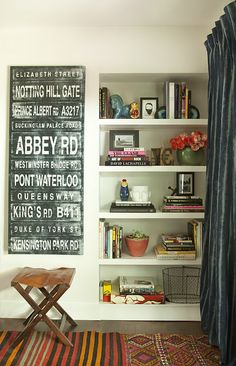 Could do in nook next to fire place when kitchen re done --- built in bookshelf, oh and that art/sign...