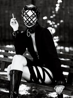 Interview Magazine - September 2011.    Photography: Mert Alas and Marcus Piggot    Blazer: Giorgio Armani.   Skirt: Void Of Course.   Mask: Heather Huey.  Choker And Cuffs: The Leather Man.  Boots: Louis Vuitton.