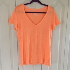 Neon AE Tee Very bright loose fit t-shirt. There's one small spot on the front. American Eagle Outfitters Tops Tees - Short Sleeve
