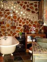 """Cordwood constrcution- part 16"""" split timber logs and part masonry (with cavity between two layers). Some glass bottles were incorporated into the construction of the bathroom wall."""