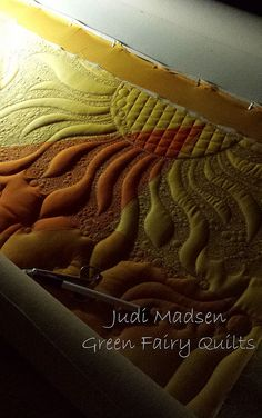 Solar Flares, hopefully this project will be finished soon!  Designed and quilted by Judi Madsen