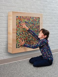 Marvelous Marble Panel - Autism Therapy - Sensory Products More than iridescent marbles fit into a steel grid on the panel that is illuminated by diffused lighting. As you turn the marbles they receive visual, tactile and aural sensory input, and ex Sensory Room Autism, Sensory Wall, Sensory Rooms, Sensory Boards, Sensory Activities, Diy Sensory Toys, Sensory Tubs, School, Toddler Activities