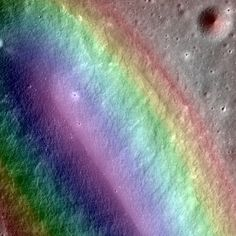 The fascinating topography of the moon's Birt E crater can be seen in this false color image. More than 3.4 billion years ago, lava sputtered out of the a volcanic vent in Mare Nubium, located on the moon's near side, carving out the Birt E crater we see today.This stunning view was captured by a camera aboard NASA's Lunar Reconnaissance Orbiter, which has been circling the moon since 2009. Credit: NASA/GSFC/Arizona State University