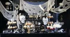 Ghoulish and Glitter Black and Silver Halloween Dessert Table. Website has other detail photos as well as a shot of matching small bar display.