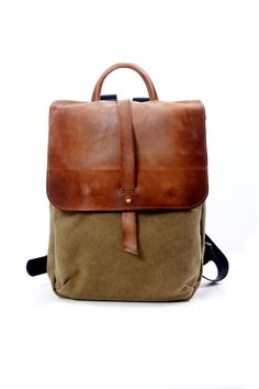 A sturdy and practical backpack for every laptop user - this backpack comes in different sizes to fit all your daily necessities! A great rucksack for school or work. This canvas and leather backpack is a convenient size, its large enough to carry your essentials, but small enough thats its light and easy to carry around. Amazing to bring on day trips! This backpack is made from the highest quality genuine soft Italian leather and strong canvas. It is tough yet soft, and best of all - its…