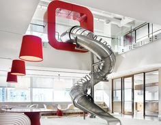 just us kids-The lounge at the bottom of the slide features Ron Arad chairs and Piergiorgio Cazzaniga tables.