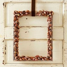 Use a frame to make a cute fall nut wreath.