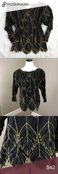 """Vintage 80's Black and Gold Embroidered Shirt This is a fantastic vintage piece. Marcia & Me & Co. It has just the right amount of over the top. Perfect for night out with jeans and black pumps. Size medium. 100% rayon. Bottom area has some lace that is see through, as shown. 42"""" bust. 40"""" waist. 24"""" long. Great condition. Vintage Tops"""