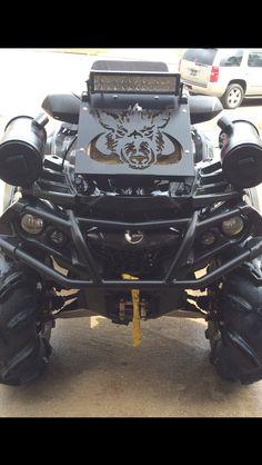 "My black 2013 Can Am Outlander 800 Max XT with: 30"" Gorilla Silverback tires, 14"" MSA Black Elixir rims, 1.5"" front & rear wheel spacers, 2"" Highlifter lift kit, Can Am snorkle kit, Cobra axles, HMF exhaust, Wild Boar radiator relocator kit, 12"" LED light bar, & Polk Audio bluetooth marine speakers."