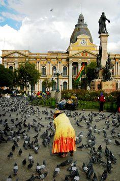 Plaza Murillo y cholita.    La Paz/Bolivia Destination: the World