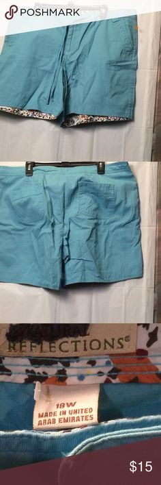 NWot  natural reflections chino shorts size 18w These are new without tags. Natural reflections brand in a pale neutral blue. Floral trim inside. Size 18w. Inseam is 7 inches. Natural waist. Button and zip. natural refections Shorts