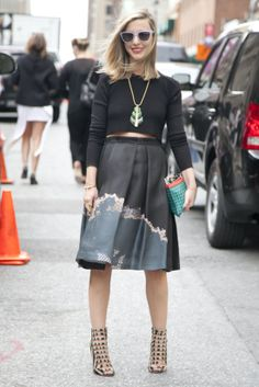 Hot Shots: The Best Street Style at NYFW (Updated!): Eva Chen paired her girlie-cool Tibi skirt with a perforated jacket.  : A full skirt said lady, but her footwear said tough girl.