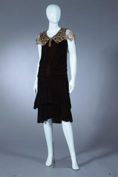 BROWN VELVET DRESS WITH LACE COLLAR, Circa 1910-1920. Sleeveless; gathered at waist, with tiered skirt; lace collar; silk slip