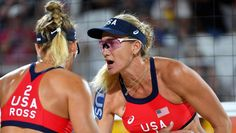 Kerri Walsh Jennings talks with teammate April Ross