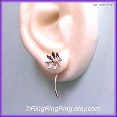 sterling silver earrings. Cute 8 petal flower with stem as earwire