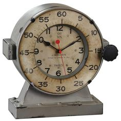 Uttermost 06096 Marine Table Clocks. Distressed, Antiqued Gray With An Antiqued, Aged Ivory Clock Face. Quartz Movement.Overall dimensions (Inches): 3.875D, 10.375W, 11H