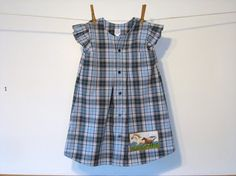 Repurposed dad's shirt turned into little girl's dress.  I really like this one.