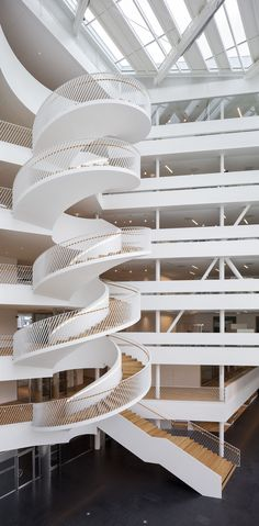 One of two spiral staircases at the Swedbank building in Landsvägen, Sundbyberg, Sweden (2014) - photo by Adam Mõrk, via archdaily; designed by 3XN Architects