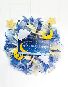 """Love you to the Moon and Back, 24"""" Baby Wreath, New Baby Wreath, Nursery Wreath, Baby Boy Wreath, Baby Girl Wreath by Splendid Homecrafts on Etsy  - All accents are handpainted, handlettered, and handsewn by Amy M. of Splendid Homecrafts"""