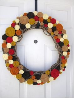 DIY - using these instructions for felt flowers: http://www.danielleburkleo.com/2010/10/diy-yarn-wreath-with-felt-flowers.html