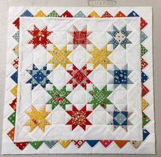 "Prairie Point quilt, miniature prairie point quilt, miniature quilt, half square triangle quilt, prairie points, 30's reproduction fabrics quilt, star quilt, miniature star quilt, quarter square triangle quilt, miniature quarter square triangles. 15.5"" square."