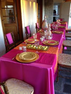 The link doesn't go to the party, but I like the bright pink and orange for tablecloths (even if they were just plastic)...or maybe throw in some green & teal, and/or dark purple & blue, too??