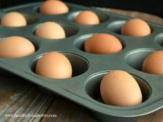 Preheat Oven to 325 degrees F and place eggs in standard muffin tin. Bake for 30 minutes. / Using tongs, remove baked eggs from muffin tin and place in ice bath until completely cool.
