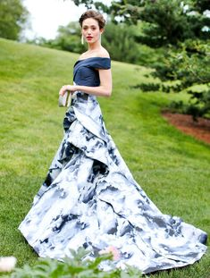 Emmy Rossum from The Best of the Red Carpet  Pause while we collect our jaws from the floor... ready? Emmy's dreamy Carolina Herrera gown achieves a level of perfection we never thought possible.