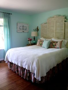 Cottage style bedroom w turquoise walls